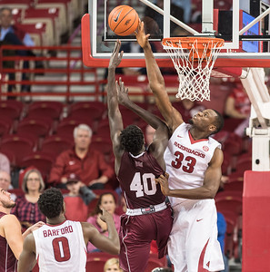 Arkansas Razorbacks forward Moses Kingsley (33) with a block during a basketball game between Arkansas and Southern Illinois University on Monday, November 14, 2016.  (Alan Jamison, Nate Allen Sports Service)
