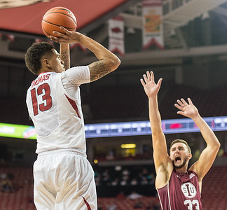 Arkansas Razorbacks forward Dustin Thomas (13) shoots during a basketball game between Arkansas and Southern Illinois University on Monday, November 14, 2016.  (Alan Jamison, Nate Allen Sports Service)