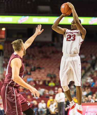 Arkansas Razorbacks guard C.J. Jones (23)] shoots during a basketball game between Arkansas and Southern Illinois University on Monday, November 14, 2016.  (Alan Jamison, Nate Allen Sports Service)