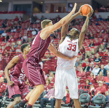 Arkansas Razorbacks forward Moses Kingsley (33) shoots during a basketball game between Arkansas and Southern Illinois University on Monday, November 14, 2016.  (Alan Jamison, Nate Allen Sports Service)