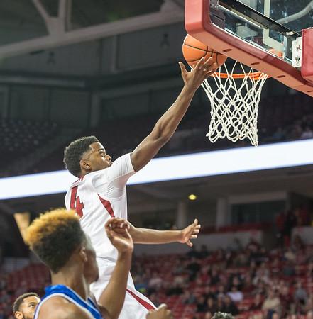 Daryl Macon shoots during a basketball game between Arkansas and UT Arlington on Friday, November 18, 2016.  (Alan Jamison, Nate Allen Sports Service)