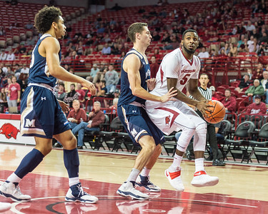 Arkansas Razorbacks forward Arlando Cook (5) drives during a basketball game between Arkansas and Mount St. Mary's on Monday, November 28, 2016.  (Alan Jamison, Nate Allen Sports Service)