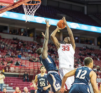 Arkansas Razorbacks forward Moses Kingsley (33) shoots during a basketball game between Arkansas and Mount St. Mary's on Monday, November 28, 2016.  (Alan Jamison, Nate Allen Sports Service)