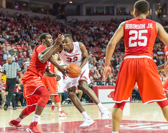Arkansas Razorbacks forward Moses Kingsley (33) takes it to the basket during a basketball game between Arkansas and Houston on Tuesday, December 6, 2016.  (Alan Jamison, Nate Allen Sports Service)