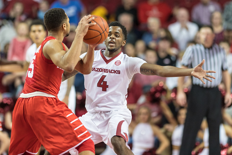Arkansas Razorbacks guard Daryl Macon (4) defends during a basketball game between Arkansas and Houston on Tuesday, December 6, 2016.  (Alan Jamison, Nate Allen Sports Service)