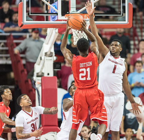 Arkansas Razorbacks forward Trey Thompson (1) defends a shot against Houston Cougars guard Damyean Dotson (21) during a basketball game between Arkansas and Houston on Tuesday, December 6, 2016.  (Alan Jamison, Nate Allen Sports Service)
