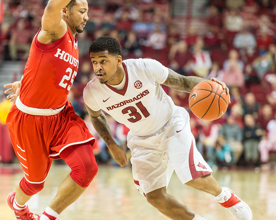 Arkansas Razorbacks guard Anton Beard (31) drives around Houston Cougars guard Galen Robinson Jr. (25)  during a basketball game between Arkansas and Houston on Tuesday, December 6, 2016.  (Alan Jamison, Nate Allen Sports Service)