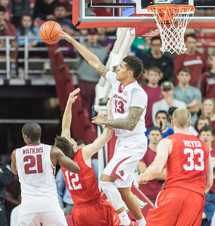Arkansas Razorbacks forward Dustin Thomas (13) deflects a shot by Houston Cougars guard Wes VanBeck (12)  during a basketball game between Arkansas and Houston on Tuesday, December 6, 2016.  (Alan Jamison, Nate Allen Sports Service)