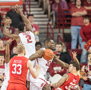 Arkansas Razorbacks forward Moses Kingsley (33) steals the ball from Houston Cougars center Kyle Meyer (33)  during a basketball game between Arkansas and Houston on Tuesday, December 6, 2016.  (Alan Jamison, Nate Allen Sports Service)