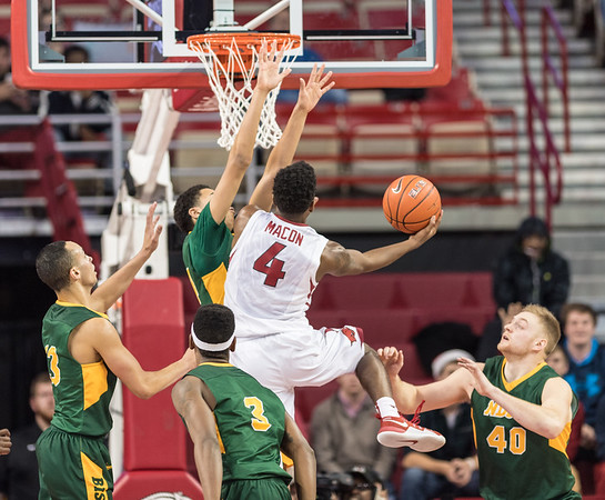 Arkansas Razorbacks guard Daryl Macon (4) shoots during a basketball game between Arkansas and North Dakota State on Tuesday, December 20, 2016.  (Alan Jamison, Nate Allen Sports Service)