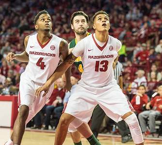Arkansas Razorbacks forward Dustin Thomas (13) and Daryl Macon (4) get in position for a rebound during a basketball game between Arkansas and North Dakota State on Tuesday, December 20, 2016.  (Alan Jamison, Nate Allen Sports Service)
