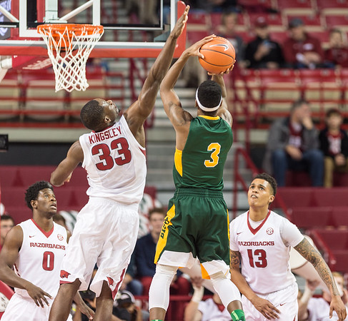 Arkansas Razorbacks forward Moses Kingsley (33) defends against North Dakota State Bison guard Carlin Dupree (3) during a basketball game between Arkansas and North Dakota State on Tuesday, December 20, 2016.  (Alan Jamison, Nate Allen Sports Service)