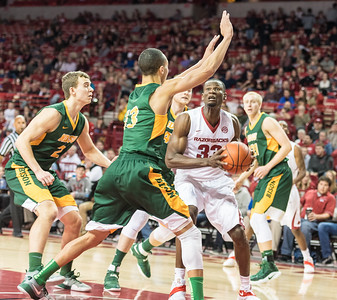 Arkansas Razorbacks forward Moses Kingsley (33) goes up in traffic during a basketball game between Arkansas and North Dakota State on Tuesday, December 20, 2016.  (Alan Jamison, Nate Allen Sports Service)