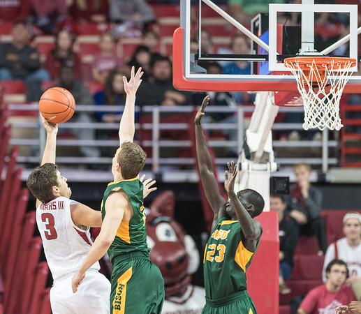 Arkansas Razorbacks guard Dusty Hannahs (3) shoots during a basketball game between Arkansas and North Dakota State on Tuesday, December 20, 2016.  (Alan Jamison, Nate Allen Sports Service)