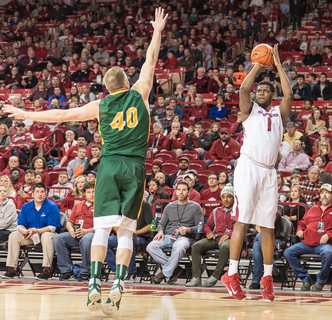 Arkansas Razorbacks forward Trey Thompson (1) shoots a three pointer during a basketball game between Arkansas and North Dakota State on Tuesday, December 20, 2016.  (Alan Jamison, Nate Allen Sports Service)