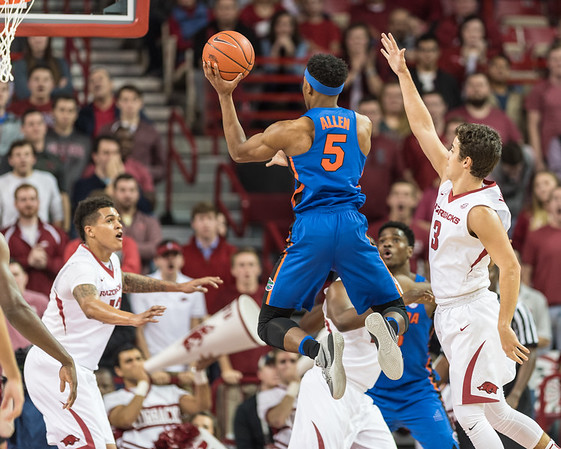 Florida Gators guard KeVaughn Allen (5) goes up for two during a basketball game between Arkansas and Florida on Thursday, December 29, 2016.  (Alan Jamison, Nate Allen Sports Service)