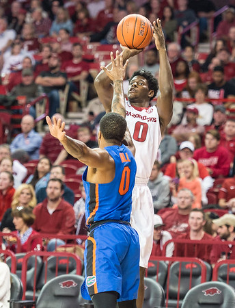 Arkansas Razorbacks guard Jaylen Barford (0) shoots a three pointer during a basketball game between Arkansas and Florida on Thursday, December 29, 2016.  (Alan Jamison, Nate Allen Sports Service)
