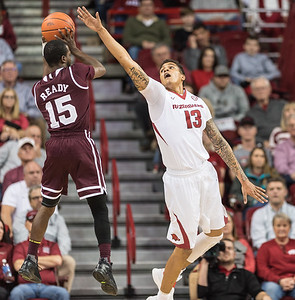 Arkansas Razorbacks forward Dustin Thomas (13) defends against Mississippi State Bulldogs guard I.J. Ready (15) during a basketball game between Arkansas and Mississippi State on Tuesday, January 10, 2017.  (Alan Jamison, Nate Allen Sports Service)