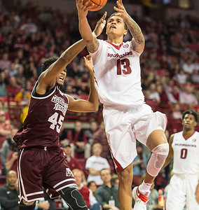 Arkansas Razorbacks forward Dustin Thomas (13) goes up for a layup during a basketball game between Arkansas and Mississippi State on Tuesday, January 10, 2017.  (Alan Jamison, Nate Allen Sports Service)