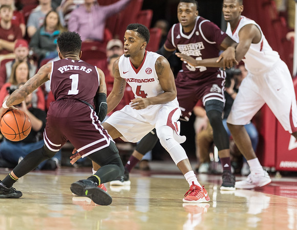 Arkansas Razorbacks guard Daryl Macon (4) defends Mississippi State Bulldogs guard Lamar Peters (1) during a basketball game between Arkansas and Mississippi State on Tuesday, January 10, 2017.  (Alan Jamison, Nate Allen Sports Service)