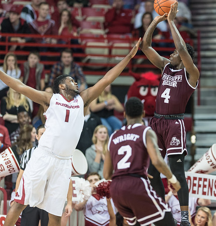 Mississippi State Bulldogs guard Mario Kegler (4) shoots over Arkansas Razorbacks forward Trey Thompson (1)  during a basketball game between Arkansas and Mississippi State on Tuesday, January 10, 2017.  (Alan Jamison, Nate Allen Sports Service)