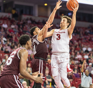 Arkansas Razorbacks guard Dusty Hannahs (3) goes up for a shot during a basketball game between Arkansas and Mississippi State on Tuesday, January 10, 2017.  (Alan Jamison, Nate Allen Sports Service)