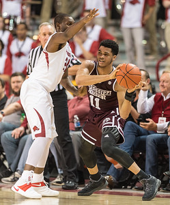 Arkansas Razorbacks guard Manuale Watkins (21) traps Mississippi State Bulldogs guard Quinndary Weatherspoon (11)  during a basketball game between Arkansas and Mississippi State on Tuesday, January 10, 2017.  (Alan Jamison, Nate Allen Sports Service)