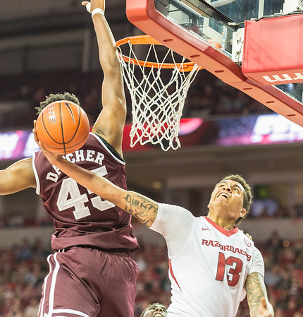 Arkansas Razorbacks forward Dustin Thomas (13) attempts a reverse layup during a basketball game between Arkansas and Mississippi State on Tuesday, January 10, 2017.  (Alan Jamison, Nate Allen Sports Service)