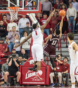 Arkansas Razorbacks forward Trey Thompson (1) defends  during a basketball game between Arkansas and Mississippi State on Tuesday, January 10, 2017.  (Alan Jamison, Nate Allen Sports Service)