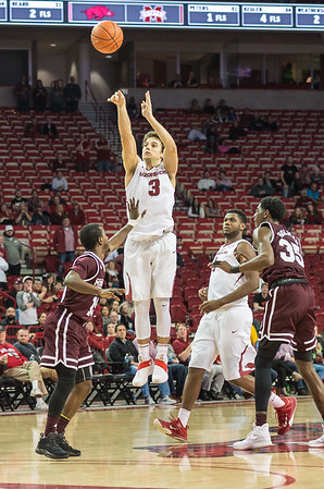 Arkansas Razorbacks guard Dusty Hannahs (3) attempts a three point shot during a basketball game between Arkansas and Mississippi State on Tuesday, January 10, 2017.  (Alan Jamison, Nate Allen Sports Service)