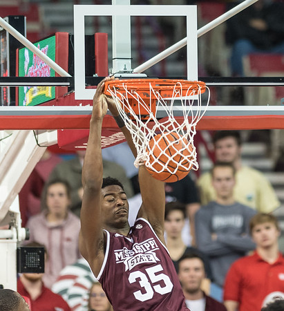 Mississippi State Bulldogs forward Aric Holman (35) dunks the ball during a basketball game between Arkansas and Mississippi State on Tuesday, January 10, 2017.  (Alan Jamison, Nate Allen Sports Service)