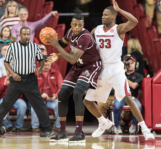 Arkansas Razorbacks forward Moses Kingsley (33) on defense during a basketball game between Arkansas and Mississippi State on Tuesday, January 10, 2017.  (Alan Jamison, Nate Allen Sports Service)