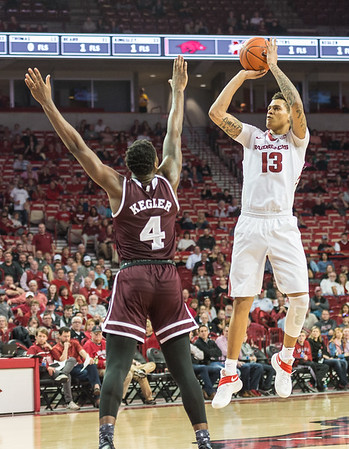 Arkansas Razorbacks forward Dustin Thomas (13) shoots over Mississippi State Bulldogs guard Mario Kegler (4)  during a basketball game between Arkansas and Mississippi State on Tuesday, January 10, 2017.  (Alan Jamison, Nate Allen Sports Service)