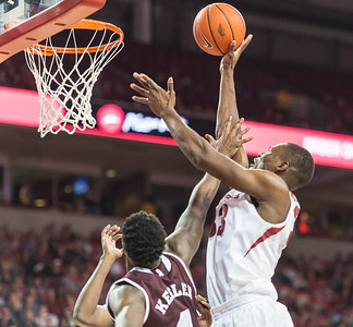 Arkansas Razorbacks forward Moses Kingsley (33) goes up for two during a basketball game between Arkansas and Mississippi State on Tuesday, January 10, 2017.  (Alan Jamison, Nate Allen Sports Service)