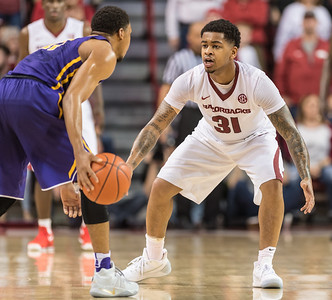 Arkansas Razorbacks guard Anton Beard (31) defends during a basketball game between Arkansas and LSU on Saturday, January 21, 2017.  (Alan Jamison, Nate Allen Sports Service)