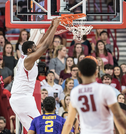 Arkansas Razorbacks forward Trey Thompson (1) with a slam on an alley-oop pass during a basketball game between Arkansas and LSU on Saturday, January 21, 2017.  (Alan Jamison, Nate Allen Sports Service)