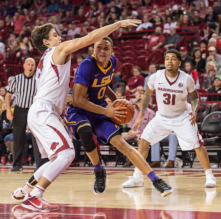 Arkansas Razorbacks guard Dusty Hannahs (3) defends against LSU Tigers guard Brandon Sampson (0) during a basketball game between Arkansas and LSU on Saturday, January 21, 2017.  (Alan Jamison, Nate Allen Sports Service)
