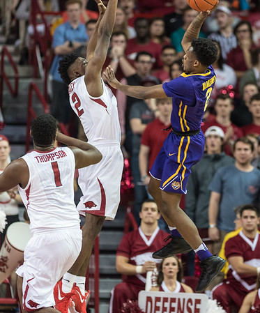 Arkansas Razorbacks forward Adrio Bailey (2) defends a shot by LSU Tigers guard Antonio Blakeney (2) during a basketball game between Arkansas and LSU on Saturday, January 21, 2017.  (Alan Jamison, Nate Allen Sports Service)