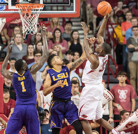 Arkansas Razorbacks forward Moses Kingsley (33) shoots over LSU Tigers forward Wayde Sims (44) during a basketball game between Arkansas and LSU on Saturday, January 21, 2017.  (Alan Jamison, Nate Allen Sports Service)