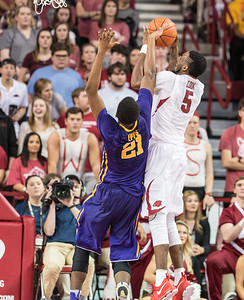 Arkansas Razorbacks forward Arlando Cook (5) shoots over LSU Tigers forward Aaron Epps (21) during a basketball game between Arkansas and LSU on Saturday, January 21, 2017.  (Alan Jamison, Nate Allen Sports Service)