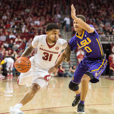 Arkansas Razorbacks guard Anton Beard (31) drives by LSU Tigers guard Brandon Sampson (0) during a basketball game between Arkansas and LSU on Saturday, January 21, 2017.  (Alan Jamison, Nate Allen Sports Service)