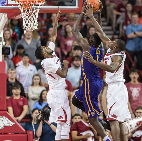 Arkansas Razorbacks forward Arlando Cook (5) and Moses Kingsley (33) defend a shot by LSU Tigers forward Duop Reath (1) during a basketball game between Arkansas and LSU on Saturday, January 21, 2017.  (Alan Jamison, Nate Allen Sports Service)