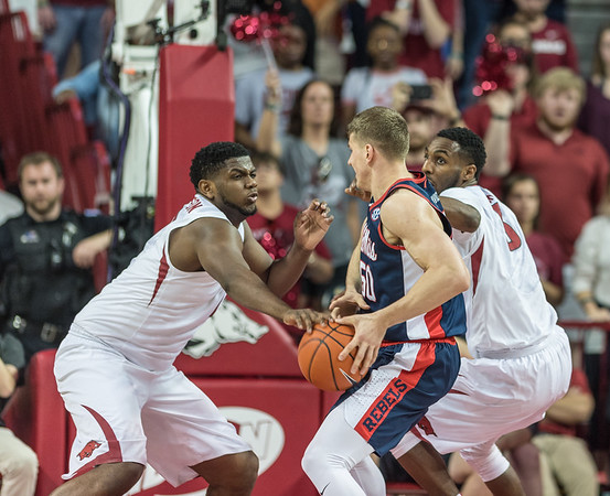 Arkansas Razorbacks forward Trey Thompson (1) strips the ball during a basketball game between Arkansas and Ole Miss on Saturday. 2/18/2017.  (Alan Jamison, Nate Allen Sports Service)