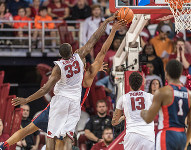 Arkansas Razorbacks forward Moses Kingsley (33) blocks a shot during a basketball game between Arkansas and Ole Miss on Saturday. 2/18/2017.  (Alan Jamison, Nate Allen Sports Service)