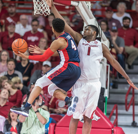 Arkansas Razorbacks forward Trey Thompson (1) defends a shot by Mississippi Rebels guard Breein Tyree (4) during a basketball game between Arkansas and Ole Miss on Saturday. 2/18/2017.  (Alan Jamison, Nate Allen Sports Service)