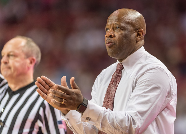 Arkansas Razorbacks head coach Mike Anderson applauds a play during a basketball game between Arkansas and Ole Miss on Saturday. 2/18/2017.  (Alan Jamison, Nate Allen Sports Service)