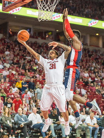 Arkansas Razorbacks guard Anton Beard (31) shoots during a basketball game between Arkansas and Ole Miss on Saturday. 2/18/2017.  (Alan Jamison, Nate Allen Sports Service)