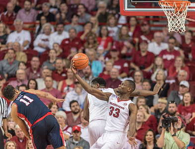 Arkansas Razorbacks forward Moses Kingsley (33) gets a rebound after blocking a shot during a basketball game between Arkansas and Ole Miss on Saturday. 2/18/2017.  (Alan Jamison, Nate Allen Sports Service)