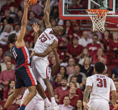 Arkansas Razorbacks forward Moses Kingsley (33) goes up for a block during a basketball game between Arkansas and Ole Miss on Saturday. 2/18/2017.  (Alan Jamison, Nate Allen Sports Service)