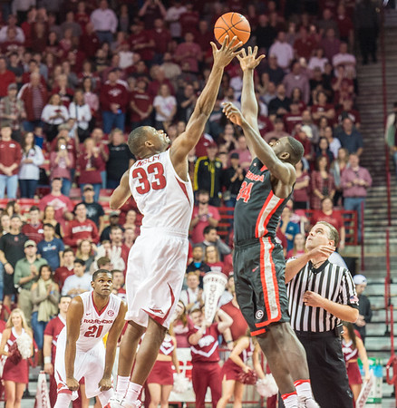Arkansas Razorbacks forward Moses Kingsley (33) controls the opening tipoff for the basketball game between Arkansas and Georgia on Saturday, 3/4/2017.  (Alan Jamison, Nate Allen Sports Service)